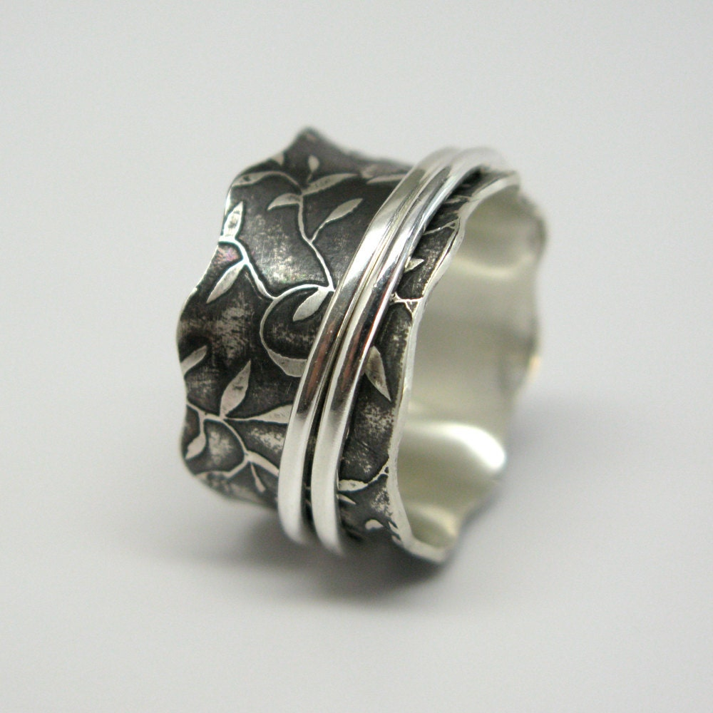 leaf pattern sterling silver spinner ring with two sterling