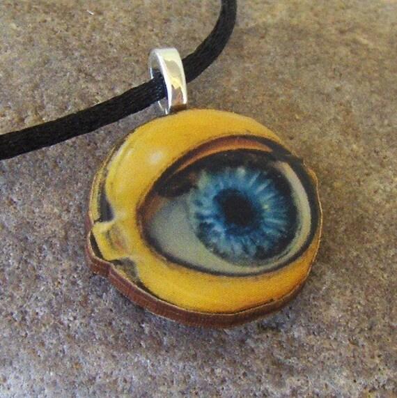 Googly eye, a wooden charm pendant