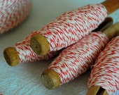 30 yards of red and white bakers twine on a vintage wooden clothes pin