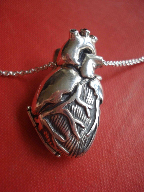 Anatomical Heart Locket with 9 Black Diamonds.