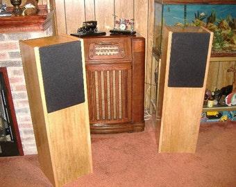 Pair of dual ten inch three way tower speakers