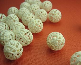 16 Vintage Filigree Plastic White Beads
