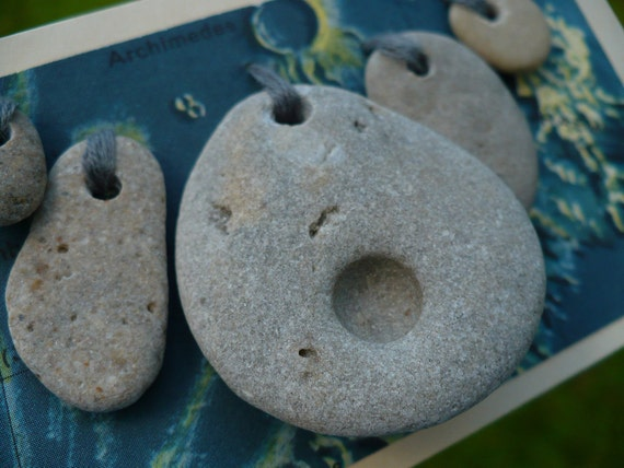 STONE CRATER...for the love of our space, beach stones, natural history, good luck fortune, natural holes pebbles grey