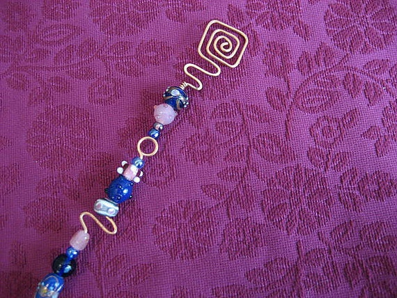 copper candle snuffer with pink and blue glass beads