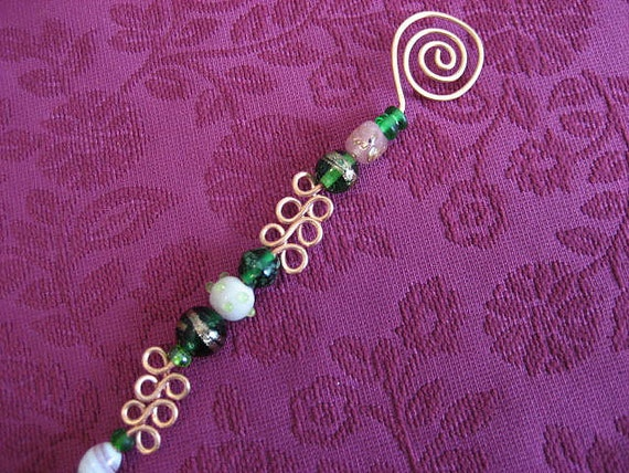 hammered copper candle snuffer with green glass beads