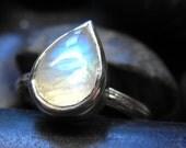 Tiny little Rain drop ring with a natural teardrop shape rainbow moonstone cabochon