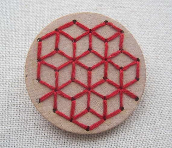 Geometric sashiko pattern embroidery on wood by