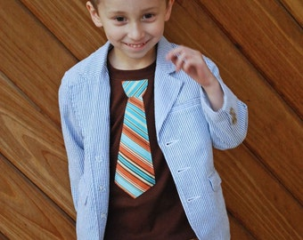 BROWN SHORT  SLEEVES TEE with an  ORANGE and BLUE STRIPES neck tie applique ........... COMFORTABLE AND TRENDY KIDS SHIRT
