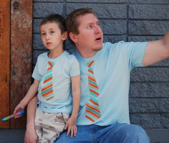 FATHER and SON...................Short Sleeves  fine jersey LIGHT BLUE T shirt with ORANGE and BLUE  Stripes NECK Tie applique.............ADORABLE  FATHERs DAY GIFT