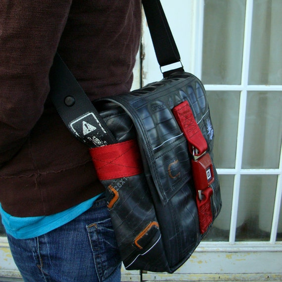 Eco friendly vegan bag made from used bike inner tubes with a reclaimed seat belt strap and buckle