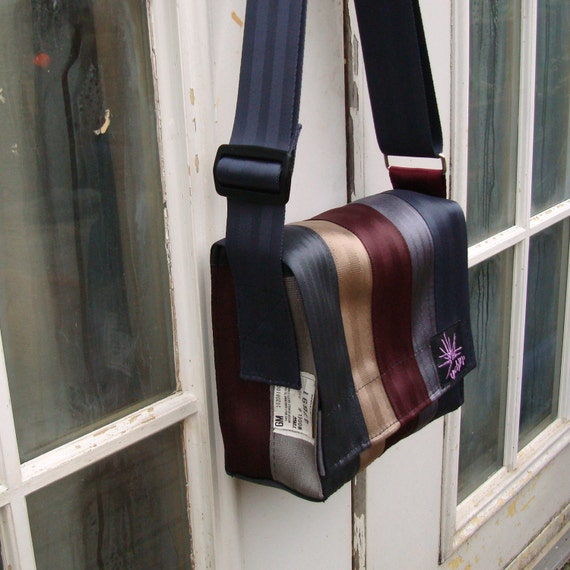 Seat belt bag made from reclaimed seatbelts.