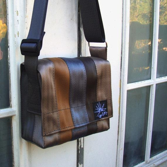Seat belt bag made from reclaimed seatbelts, bike inner tube