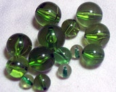 14 Green glass round beads - various sizes
