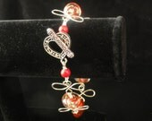 Red and floral lampwork bead with wire wrapped Swirl Bracelet
