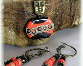 Four lampwork beads and smiling faces in this necklace earring set