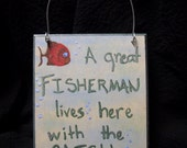 A great fisherman lives here with the catch of his life Plaque