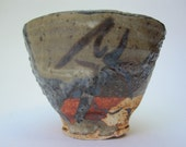 Pocked teacup, saki cup in clay gathered from sand tailings dam