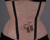 MASQ CUSTOM fake leather pale pink corset with black details and fake bullets. Tight lacing, waist training