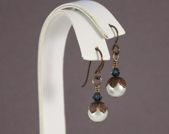 Brown Niobium pierced earrings with Swarovski Cream and Montana Blue