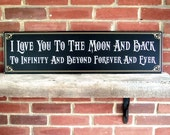 items similar to i love you to the moon and back wood sign