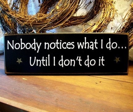 nobody notices what i do painted wood wall sign by