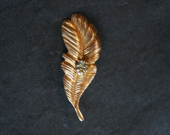 Feather brooch with stone, gold toned pin