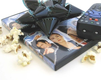 Film Reel Gift Packaging Bows - Set of 3 Bows - Repurposed from the movie Problem Child - Gift Wrapping - Upcycled 35mm Film Gift Bow