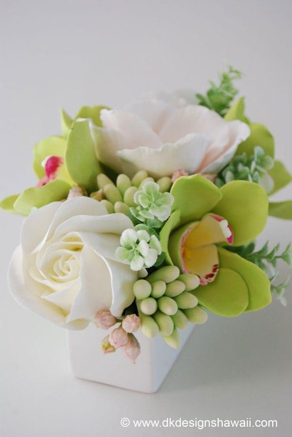 CLAYCRAFT by DECO - Green Cymbidium Orchid, Ivory Rose, Blush Peach Lisianthus and Tuberose in Rectangular White Vase