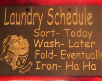 Wooden sign laundry schedule