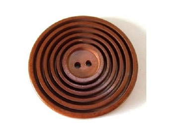 Antique vintage plastic button, carved circles large 44mm, 5mm thick, warm brown