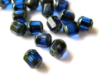 12 Glass beads blue faceted beautiful 8mmX7mm