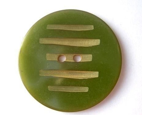 2 Antique bakelite vintage buttons, collectibles, olive green color, tested positive for bakelite, carved, large, 34mm