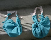 Two Blue Purses are True Blue