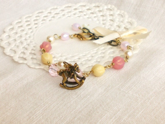 "Romantic vintage style bracelet ""Adventures on a rocking horse"" in dusty pink and cream"