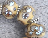 Tikibeads Silvery Aurae Designs On Ivory Colored Lampwork Beads SRA