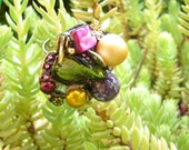 pink violet green and gold ring
