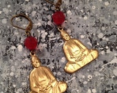 earrings made from brass buddha charms & candy red lucite beads that dangle from antiqued brass ear wires