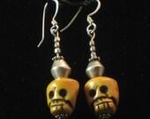 Earrings: hand-carved bone skull beads
