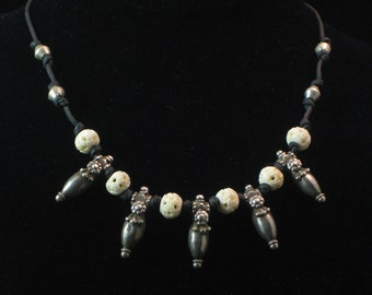 Necklace: rare, old Afghani amulets with carved bone beads