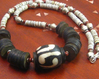 Necklace: African batik bead with coconut shell and mother of pearl heshi