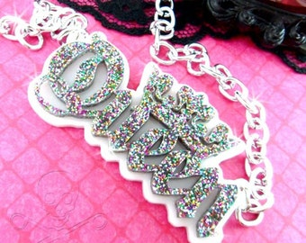 QUEEN -  Laser Cut Acrylic Necklace In White And Rainbow Glitter