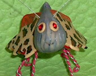 Carmine, a bug sculpture