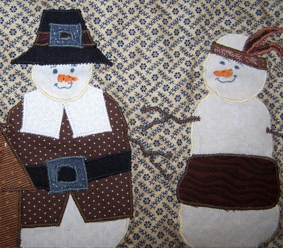 First Thanksgiving quilted wall hanging with snowman pilgrim and indian