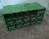 industrial green metal parts drawers