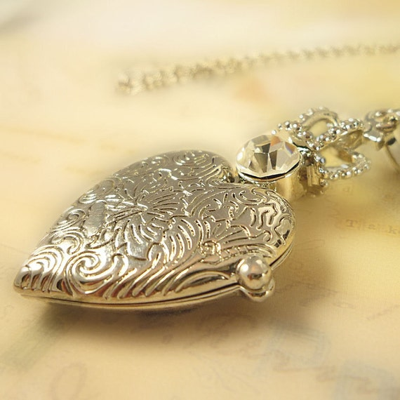 Royalty . Large etched heart locket with rhinestone and crown necklace