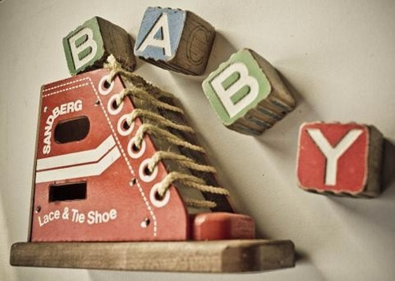 Antique toy, wooden lace and tie shoe
