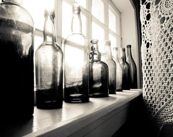 Black and white kitchen art photography print vintage glass bottles crochet lace window monochrome wall art - Many Stories to Tell