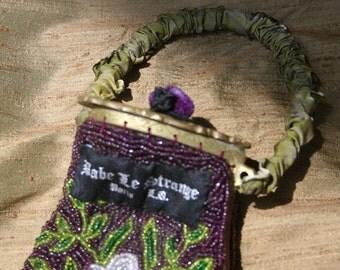 brass and plum purple hand beaded bag