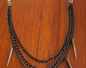 Multi chain rocker chick black spiked necklace.