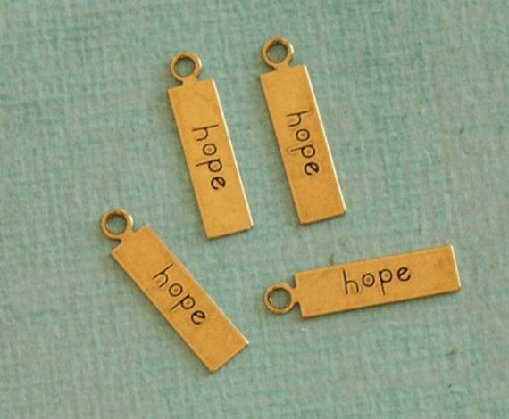 4 Brass Hope Charms 2332
